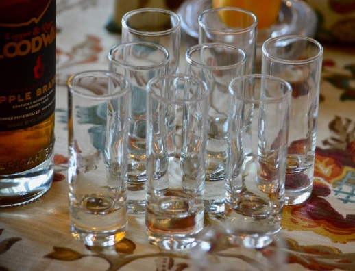 Empty shot glasses awaiting some apple brandy.